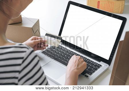 Woman's hands using credit card register and payments online shopping and customer service network connection market using technology on laptop Internet Online shopping or internet banking concept.