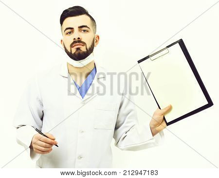 Treatment And Ambulance Services Concept. Doctor With Beard Holds Folder