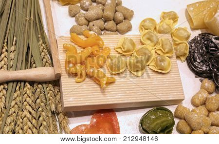 Cutting Board With Ravioli And Fresh Pasta With Black Cuttlefish
