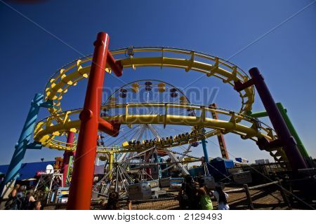 Roller Coaster Track And Ferris Wheel