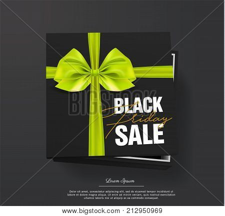 Black friday sale Black cardboard box tied with a golden ribbon and gold bow is lying on a black background. Black friday Top view. Template for the poster, banner and web.