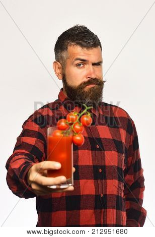 Guy With Harvest. Man With Beard Holds Glass Of Juice