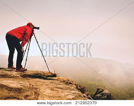 Professional Photographer Work On Mountain Peak. Nature Photographer Takes Photos With Mirror Camera