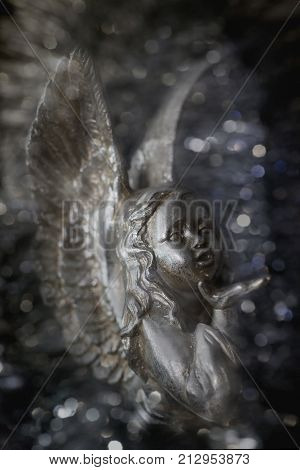 an angel silver colour with a sparkly bright background