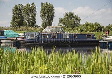 barges moored on a canal with colourful surroundings