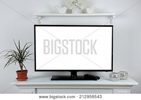 Blank TV display on stand in living room