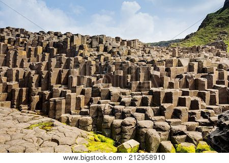 The Giants Causeway in County Antrim of Northern Ireland is declared a World Heritage Site by UNESCO containing about 40000 interlocking basalt columns being a result of an ancient volcanic eruption