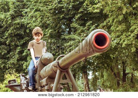 The boy imitates a stub from a gun