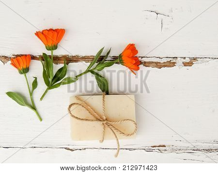 Handmade spa calendula soap on vintage wooden background. Soap making. Soap bars. Spa, skin care.