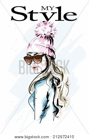 Hand drawn fashion woman in knitted hat with fur pompom. Stylish beautiful young woman portrait. Cute girl in winter clothes. Sketch.
