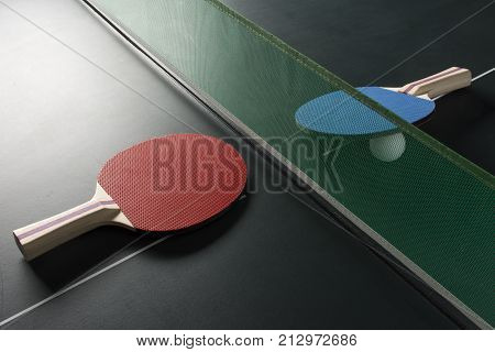 Ping Pong Paddles On Table With Net, Harsh Light