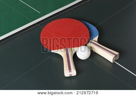 Ping Pong Paddles On Table, Both On Same Side