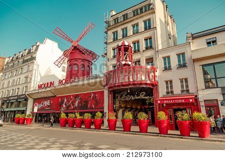 Paris, France, March 31 2017: Moulin Rouge is a famous cabaret built in 1889, locating in the Paris red-light district of Pigalle