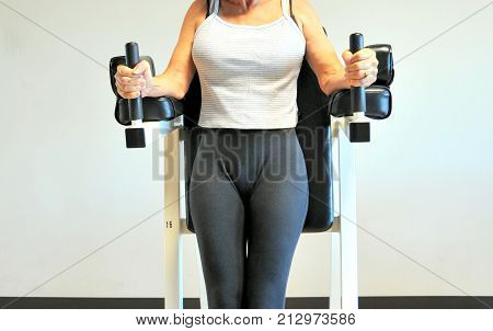Sexy mature female beauty working out inside a healthclub.