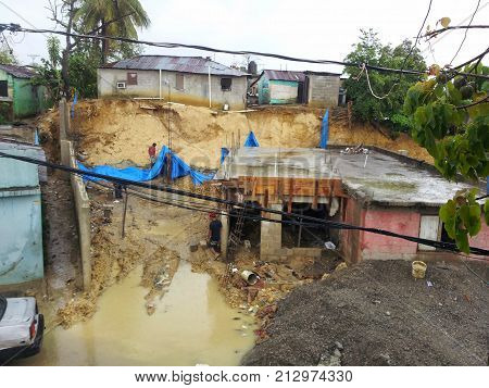 SANTO DOMINGO, DOMINICAN REPUBLIC - MAY 30, 2013: Collapse by storm in a poor neighborhood