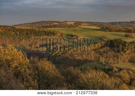 Autumn evening view from Varhost hill in Ceske Stredohori mountains