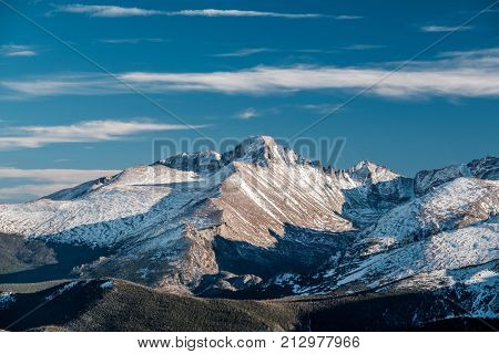 High alpine tundra landscape with rocks and mountains at autumn. Rocky Mountain National Park in Colorado, USA.