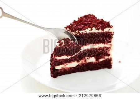 Spoon Cutting A Red Dessert