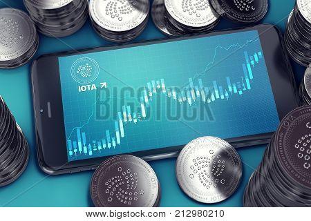 Smartphone with IOTA growth chart on-screen among piles of IOTA coins. IOTA growth concept. 3D rendering