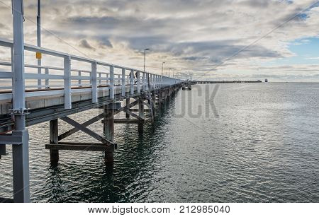 The longest wooden jetty in the world at cloudy evening.Busselton Jetty-Western Australia.