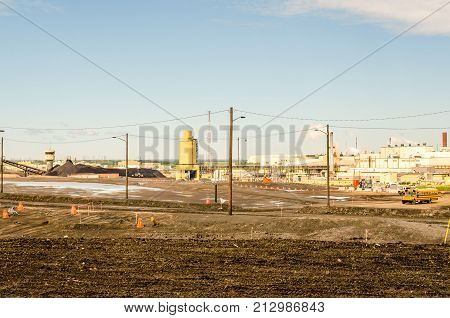 Industrial landscape and heavy equipment for oil sands industry pollution environment.