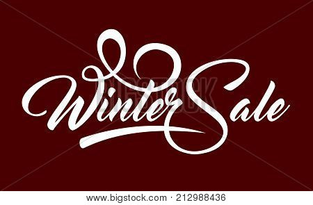 White caligraphic text Winter Sale on red background.