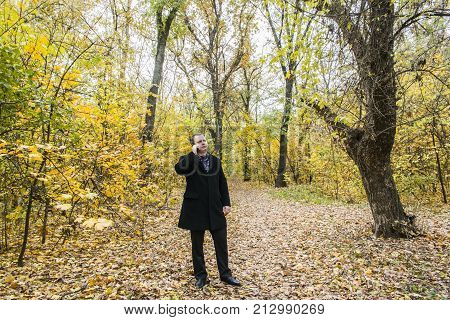 A Middle-aged Man In The Autumn Park.