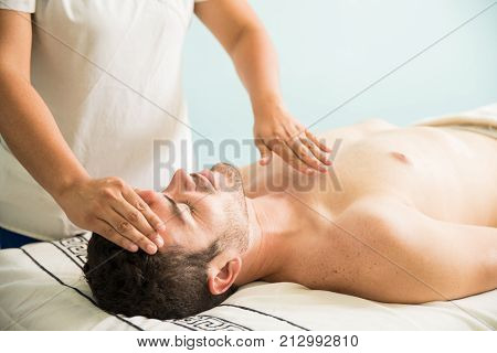 Reiki Therapy On A Young Man