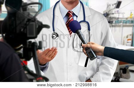 Press interview with medical doctor in hospital