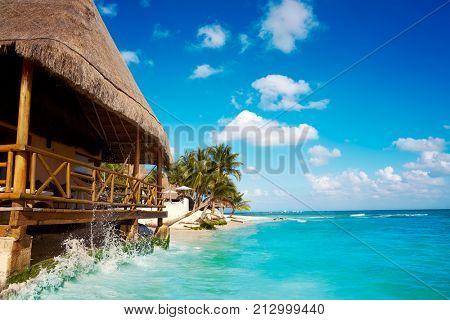 Playa del Carmen beach palapa in Riviera Maya Caribbean at Mayan Mexico