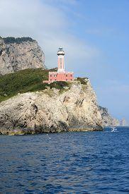 Punta Carina, red lighthouse on the island of Capri (Italy).