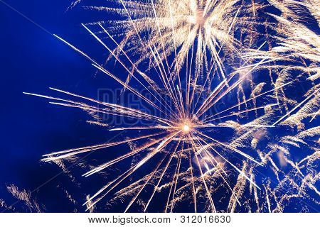 Inexpensive Fireworks Over The City Yellow, Blue And White. Bright And Shiny.  For Any Purpose. Cele