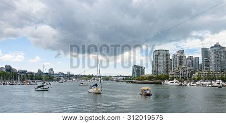 Panoramic Summer View Of Vancouver City With Thunderclouds And Bay With Yachts, British Columbia Can