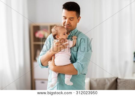 family, parenthood and fatherhood concept - middle aged father with little baby daughter at home poster