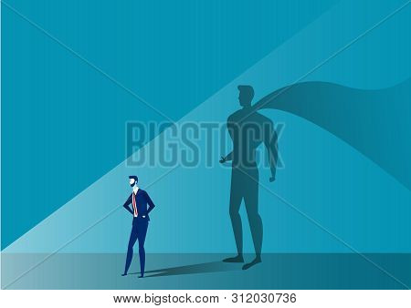 Business Man With Big Shadow Superhero On Blue Background