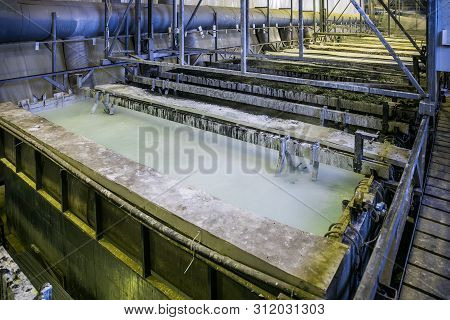 Etching Acid Containers For Galvanizing Metal Parts In Galvanic Workshop.
