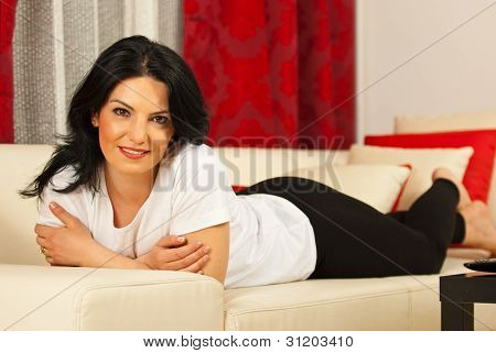 Attractive Woman Laying On Sofa