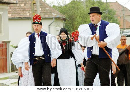 SIC, ROMANIA - CIRCA JUNE, 2004: Unidentified bride and groom attend their traditional Hungarian wed