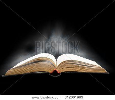 Old Open Book On The Artistic Background