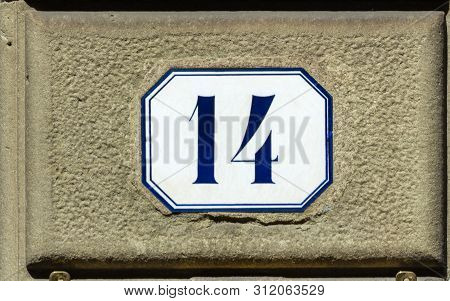 House Number Fourteen ( 14 ) On A Roughcast Wall