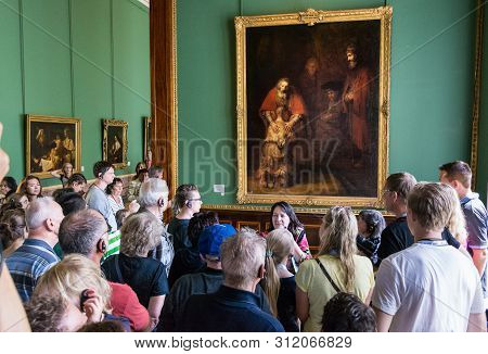 Visitors Admire Paintings By Rembrandt,
