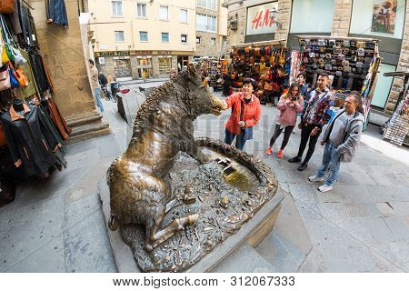 Florence, Italy - May 11, 2019: Fontana Del Porcellino, A Bronze Boar Rubbed By Thousands Of Hands F