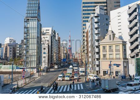 Tokyo, Japan - Mar 15, 2019: View Of Tokyo Tower And A Busy Street In Japan. It Is A Prominent Landm