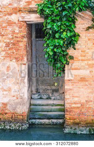 Venice, Italy - May 14, 2019: Typical Antique Door In Venice