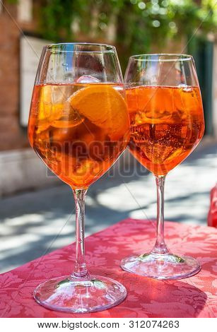 A Glass With Bright Orange Liquid, Ice And A Slice Of Orange, Spritz Aperol Cocktail