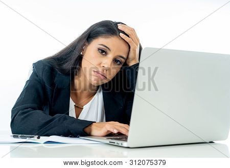 Young Beautiful Businesswoman Bored And Overwhelmed Working On Computer