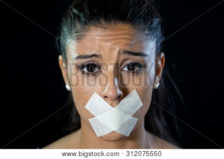 Attractive Frightened Young Woman Mouth Sealed On Adhesive Tape