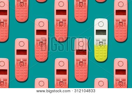 Pattern Image Of Dect Phones Turning Into A Toy Phones On Blue Background. The Concept Of Technology