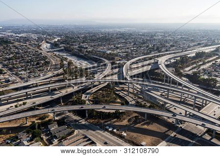 Aerial view of the Harbor 110 and 105 freeway interchange ramps and bridges near downtown Los Angeles in Southern California.