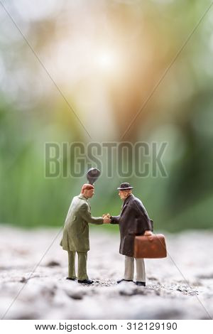 Miniature People : Business People Meeting Greeting Shaking Hands Outdoor Scene , Connecting People